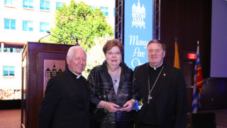 Former Seton Hall President Robert Sheeran, Dr.Mary Meehan and Cardinal JosephTobin pose for a picture