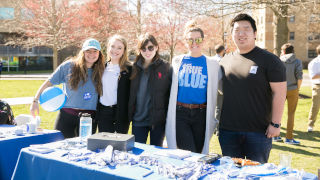Students at a table during Giving day