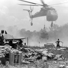 Black and white photo of a helicopter in Vietnam during the war
