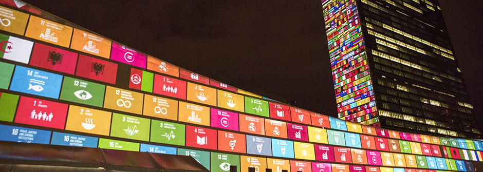 UN Building lit up in rainbow colored tiles.