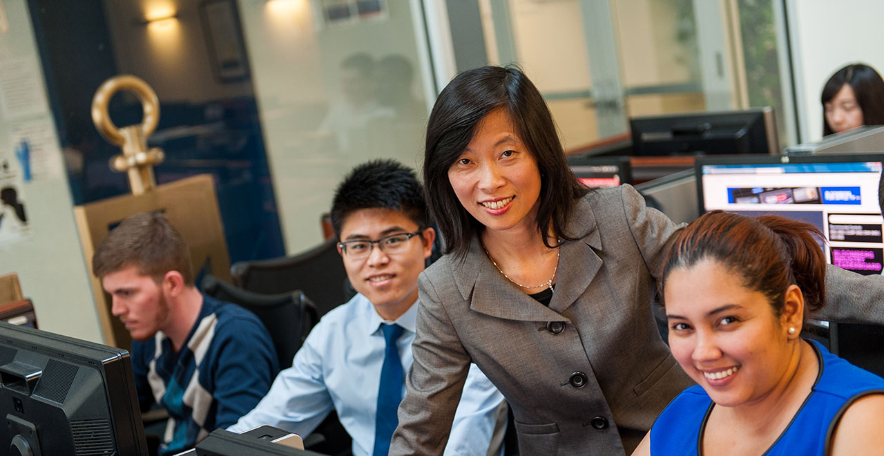 Business Students with Professor Xu in the Trading Room