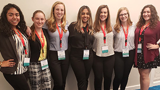 A group photo of Speech Language Pathology students at a conference.