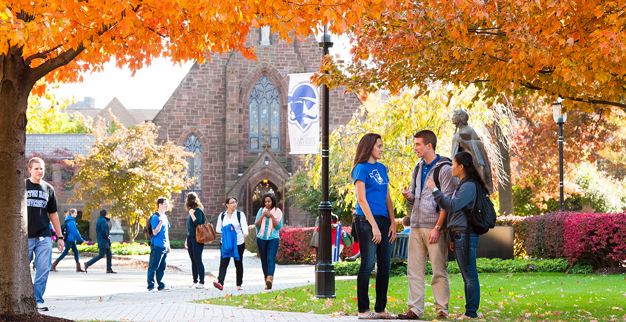 Students on the Seton Hall campus during a Fall day.