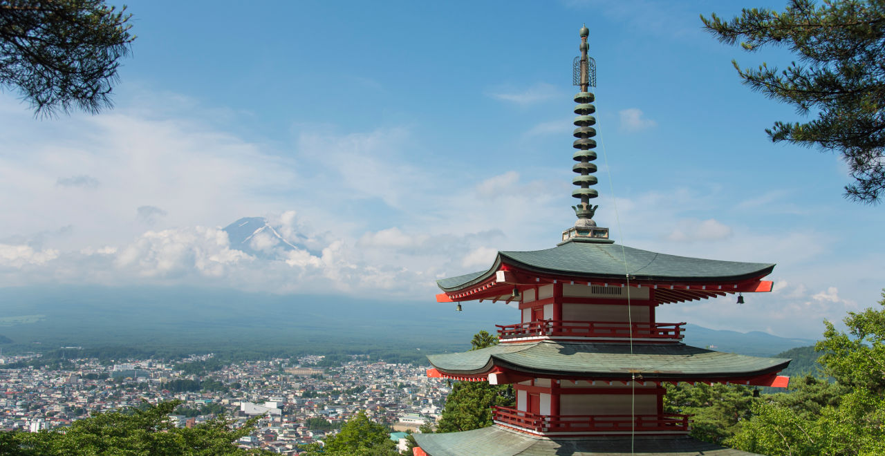 Japanese temple looking upon town and mountains.