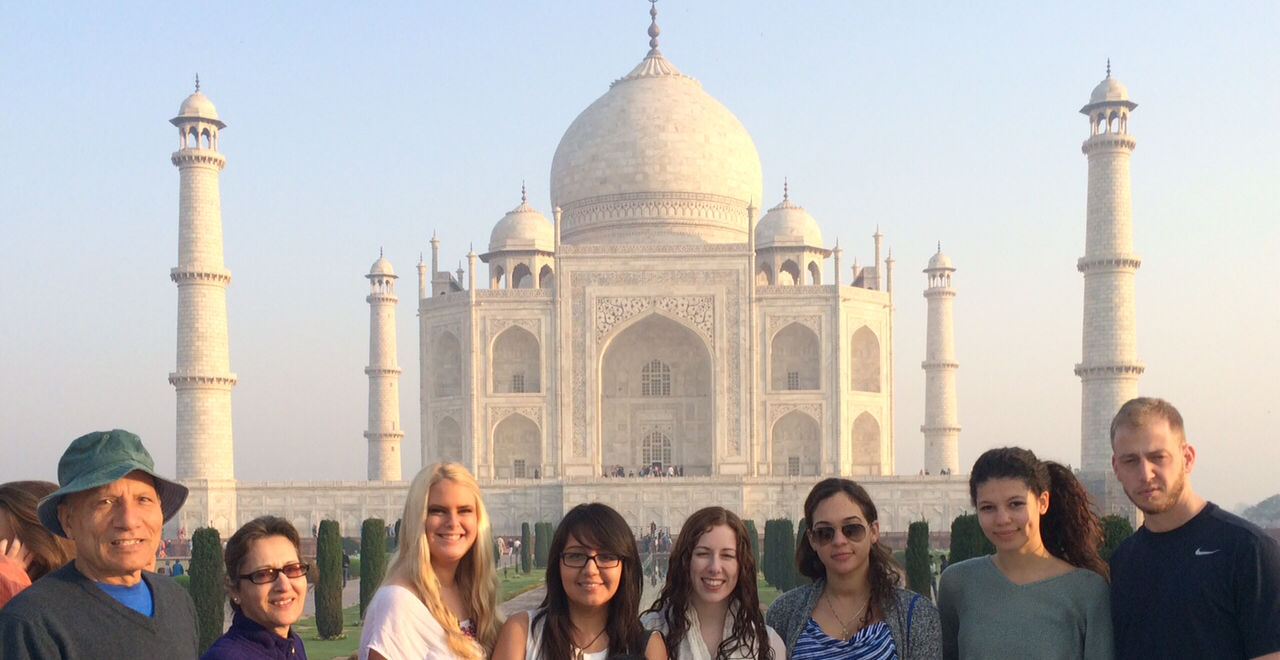 Students studying abroad in India in front of the Taj Mahal.